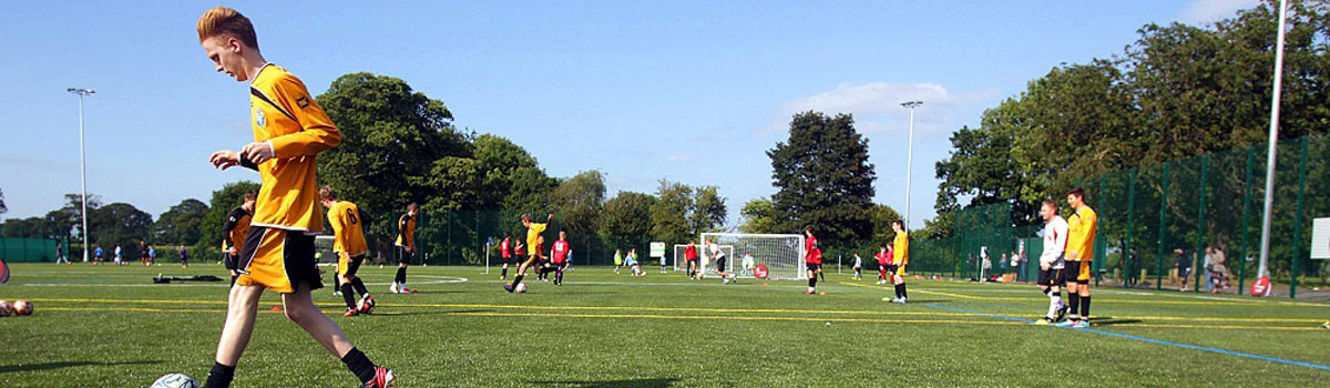 Football game being played at Christleton All Weather Pitch